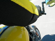 Reflections on Motorcycle Ride. Motorcyclist is reflected in mirror of sport bike.  Motorcyclist in protective gear and coordinating colors Stock Images