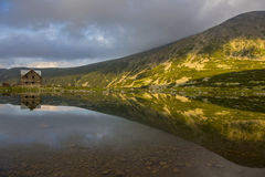 Reflections in a mountain lake at sunset Stock Photo