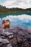 Reflections in a mountain lake Stock Image