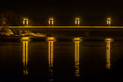 Reflections at night from Prienai bridge. Bridge Light reflections on river Nemunas in Prienai, Lithuania at night Royalty Free Stock Photos