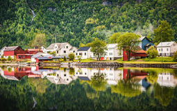 Reflections of Norway. Perfect reflections of the houses on the fjord in Norwayn Royalty Free Stock Photos