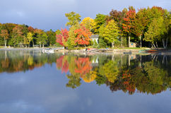 Reflections Of Fall Colors On A Tranquil Lake Stock Photos