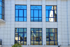 Reflections of old building in windows in Lodz Royalty Free Stock Photography