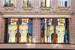 Reflections of old building in windows in Lodz Stock Photo