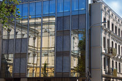 Reflections of old building in windows in Lodz Stock Image