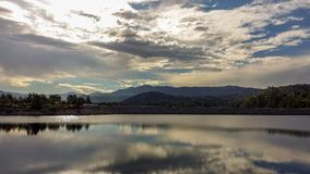 Reflections on Papoose Lake In Southern California. With blues, grays and silhouettes Stock Photography