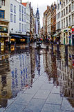 Reflections on the pavement street in a rainy day. Brussels, Bel Royalty Free Stock Photo