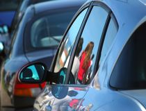 Reflections of people on cars Stock Photos