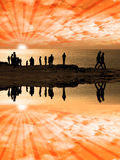 Reflections of people on the cliff edge Stock Image