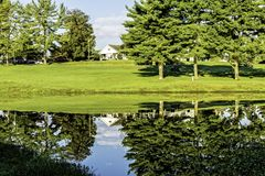 Reflections. This photo was taken at a charity golfing event. The building is the golf clubhouse Stock Photo