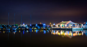 Reflections of a pier and boats in the Potomac River at night, i Royalty Free Stock Image