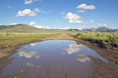 Reflections in pond of western mountains in Centennial Valley near Lakeview, MT Royalty Free Stock Images