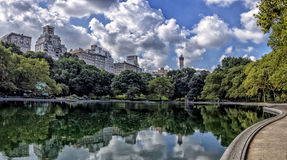 Reflections in a pool - NYC, central park. Buildings are reflected in a pool in NYC's central park Stock Photo