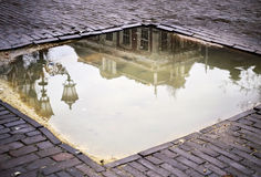 Reflections on a rain pond Stock Photos