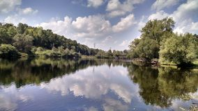 Reflections on the raquett. Beautiful day on the river with Renee Royalty Free Stock Image