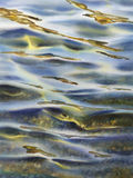 Reflections rays watercolor. Sea view background. Blue sea or ocean transparent shallow water over pebble bottom of stony beach coast. Wave is incident on the Stock Photo