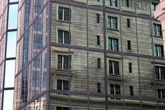 Reflections. Reflection of concrete building on mirrored glass building Stock Photography