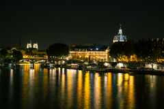 Reflections on River Seine in Paris at night. Romantic view over the River Seine in Paris Royalty Free Stock Photos