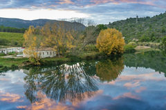 Reflections in the river at sunset. River near the village of Vallat. Castellon. Valencian Community Stock Photo