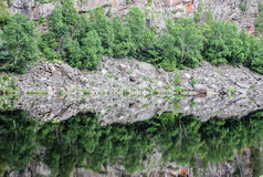 Reflections. Of rocks and trees in a lake Stock Photography