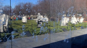 Reflections of sculptures and sightseers in the Mural Wall,Korean Veterans Memorial,Washington,DC,2015 Royalty Free Stock Photos