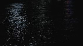 Reflections on the sea waves at night. Refletions on the sea waves at night. Wide shot stock footage