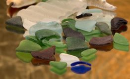 Reflections of Seaglass. Reflections of Colored Seaglass on glass Royalty Free Stock Photo