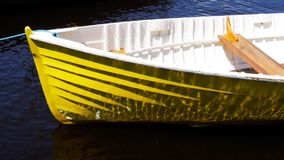Reflections on the side of a dinghy. Reflections dance on the side of a yellow dinghy in Tasmania stock video footage