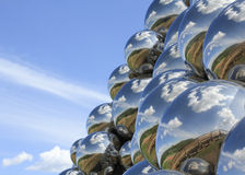 Reflections. Of the sky and clouds in a tower of silver balls Royalty Free Stock Image