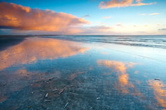 Reflections of sky in North sea Stock Images