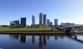 Reflections of skyscrapers. Skyscrapers nearby river in the city Stock Image