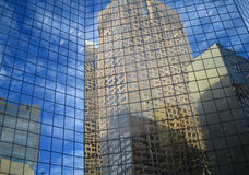 Reflections of Skyscrapers. A reflection of skyscrapers in the windows of another skyscraper Royalty Free Stock Image