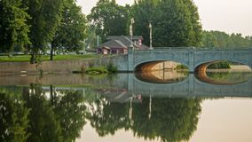 Reflections On The Speed River In Guelph, Ontario, Canada. Looking northeast at the Gordon Street Bridge on the Speed River in Guelph, Ontario, Canada royalty free stock image