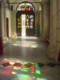 Reflections of stained glass windows. At the Church of St. Minas in Heraklion, Crete Greece Stock Photography