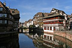 Reflections in Strasbourg. Traditional houses near the river Rhein, Strasbourg, France Stock Photos