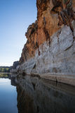 Reflections of the Stunning Devonian limestone cliffs of Geikie Gorge. Stunning Devonian limestone cliffs of Geikie Gorge where the Fitzroy River carves its way stock photos