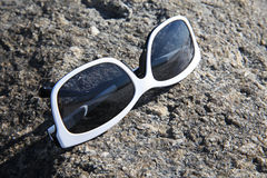 Reflections. In sunglasses on rock Stock Photos