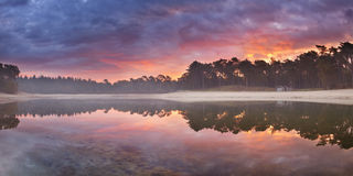 Reflections of sunrise at quiet lake in The Netherlands Royalty Free Stock Photo