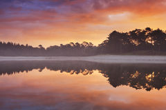 Reflections of sunrise at a quiet lake in The Netherlands Stock Image