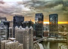 Reflections of sunset and Chicago cityscape on the reflective buildings and river. Royalty Free Stock Image