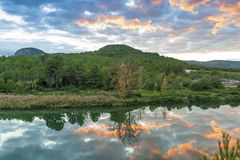 Reflections at sunset on the river Mijares. In Vallat village. Valencian community Stock Photo