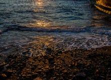 Reflections at sunset on Tuscany coast Royalty Free Stock Photos