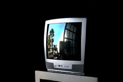Reflections in television. Reflections of palm tree in television screen Royalty Free Stock Photos