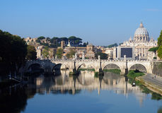 Reflections on the Tiber River, Rome. The Tiber River and St. Peter's Basilica in the background. Rome, Italy stock photo