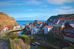 Reflections towards the harbour in Staithes, in North Yorkshire. Taken to capture the beautiful land based entrance to the harbour in Staithes, near Scarborough stock photos