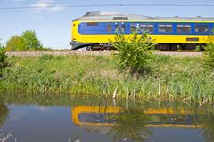 Reflections of train in the water in Hoogeveen, Netherlands Royalty Free Stock Photos