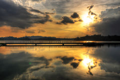 Reflections of a warm orange Sunset. Reflections during sunset at Upper Pierce Reservoir Park, Singapore Royalty Free Stock Photography