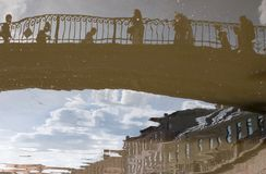 Reflections on the water. Bridge and buildings reflections on the water Stock Images