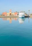 Reflections of the water on boat anchored at a marina Stock Image