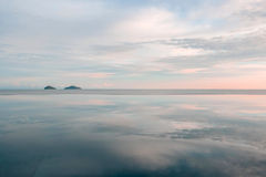 Reflections in the water . Clouds . Ocean. Royalty Free Stock Images